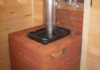 Облицовка металлической печи в бане кирпичом