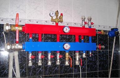 Контрольно-измерительные приборы на коллекторе отопления